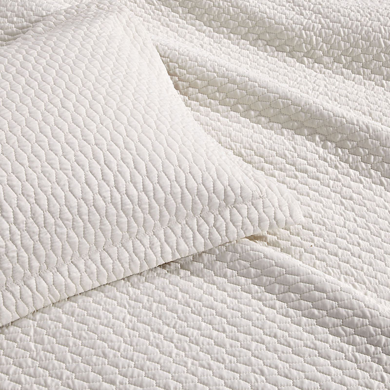square quilted bedspread